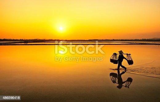 istock Salt farmer after wholeday working, Hon Khoi,Nha Trang,Vietnam 486596418