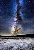 Salt flats macro at night in Badwater basin, death valley national park with milky way in the background. California. USA