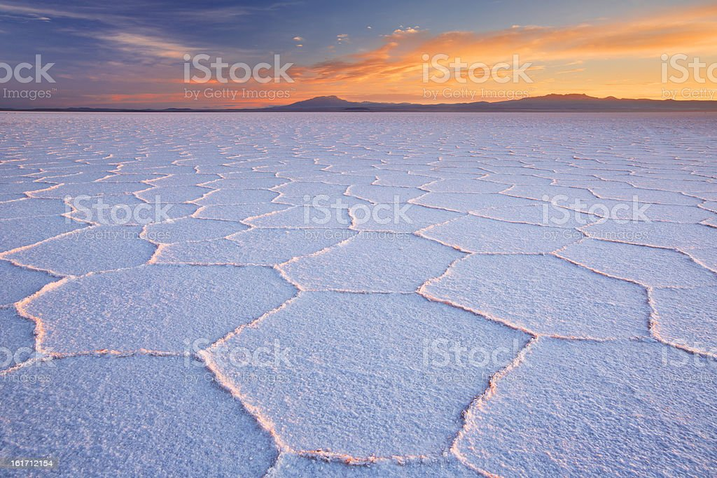 Salt flat Salar de Uyuni in Bolivia at sunrise stock photo