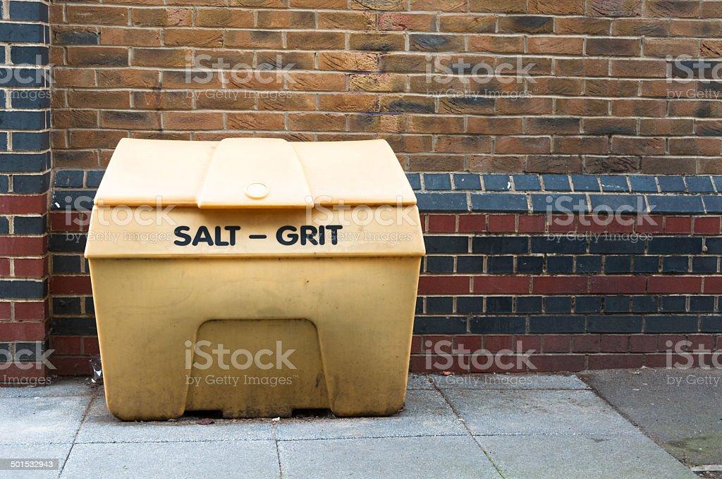 Salt Grit bin against a brick wall stock photo