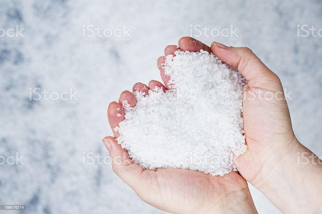 salt heart and hands stock photo
