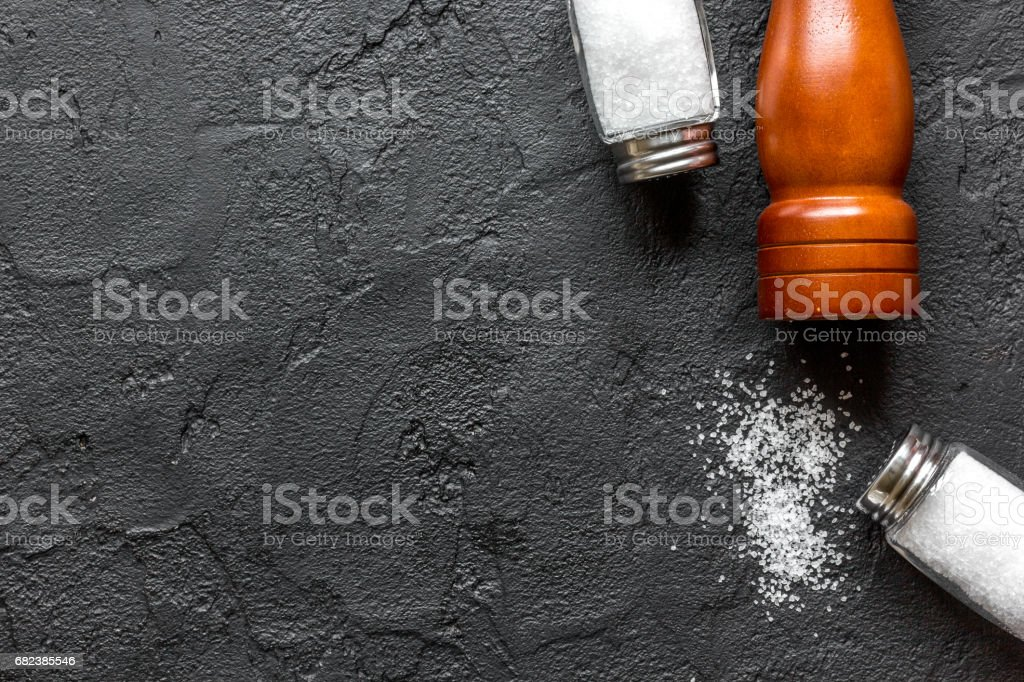 salt in bottle with saltcellar for spices set dark background top view mockup royalty-free stock photo
