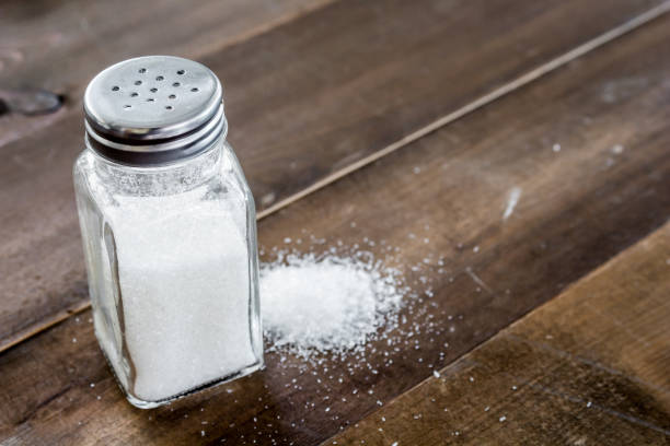 salt in wooden table - salt foto e immagini stock