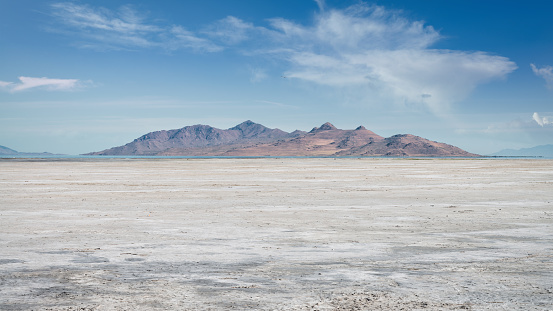 Salt Lake City Salt Flats Desert Panorama under blue sunny summer skyscape close to the city of Bonneville, Salt Lake City, Utah, USA.