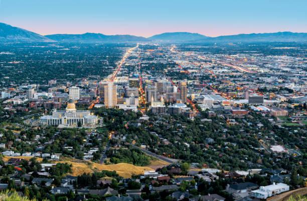 Salt Lake City downtown landmarks illuminated dusk panorama Utah USA aerial view stock photo