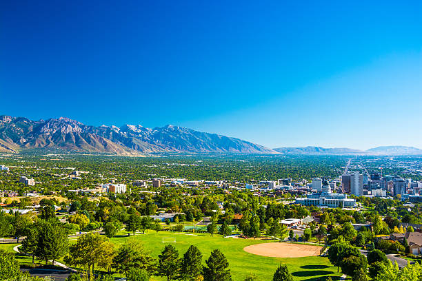 salt lake city skyline aerial view with mountains and park - skyline mountains usa stock photos and pictures