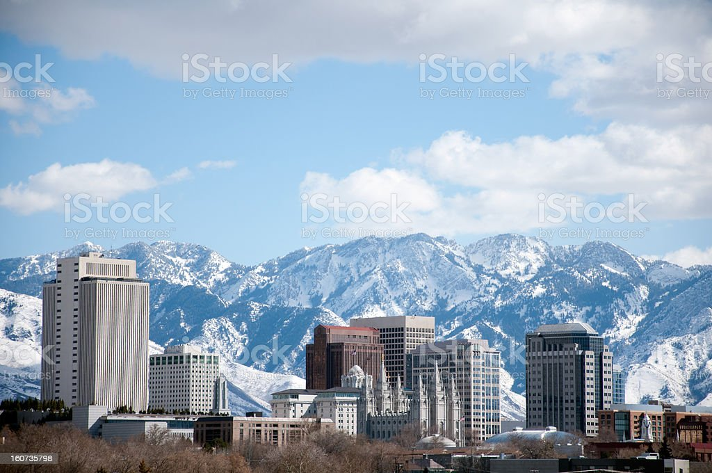 Salt Lake City Utah Winter Skyline With Snow Covered Mountains stock photo