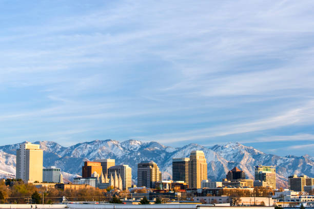 salt lake city with snow capped mountain - skyline mountains usa stock photos and pictures