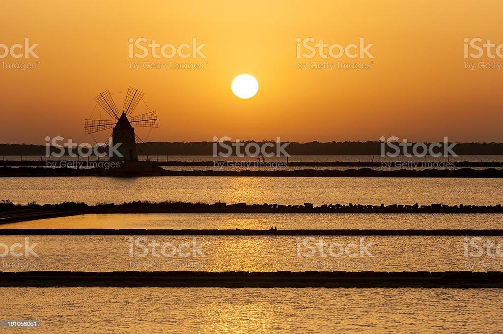 Salt mill near Trapani, Sicily - Saline di Marsala stock photo