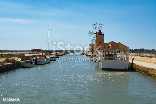 Sea saltworks, salt wind mills are seen in suburbs of Marsala, Sicily, Italy.