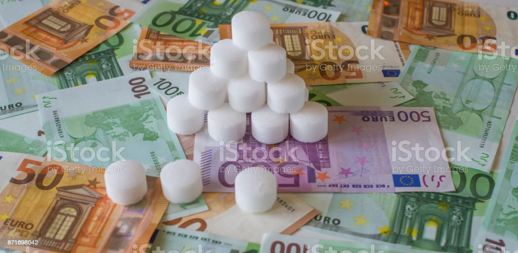 Salt pellets for the water softener on the background of Euro banknotes stock photo