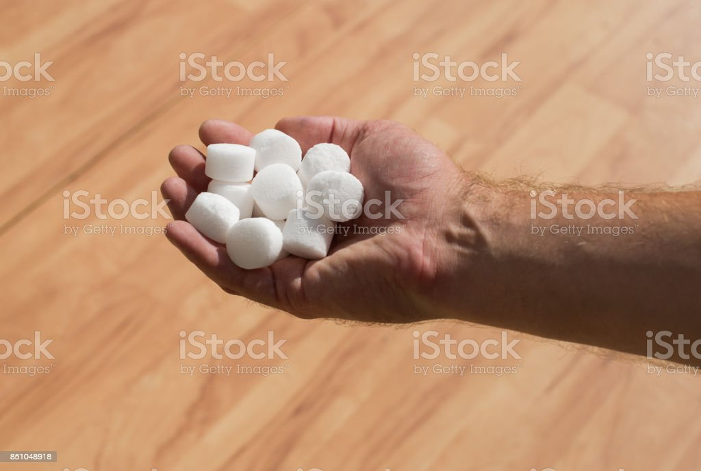 Salt pellets for the water softener stock photo