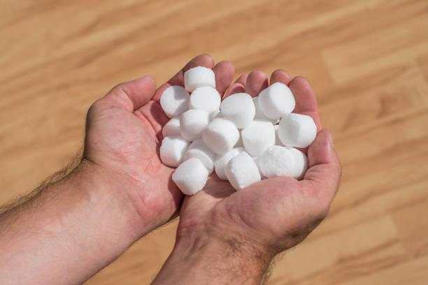 Salt pellets for the water softener stock photo