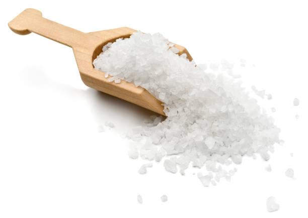 Salt Sea salt in a serving scoop.  salt stock pictures, royalty-free photos & images