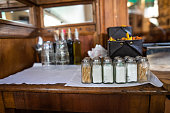 Salt shakers and toothpicks on bar counter at restaurant