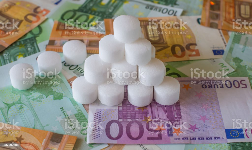 Salt white granules on the background of Euro banknotes stock photo