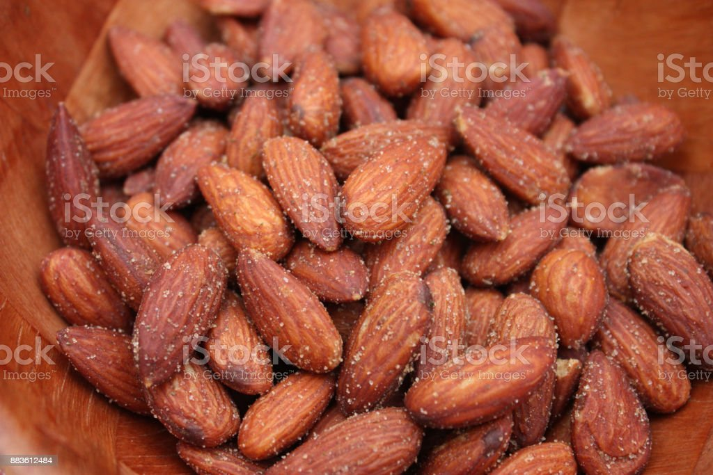 Salted almonds for aperitif stock photo