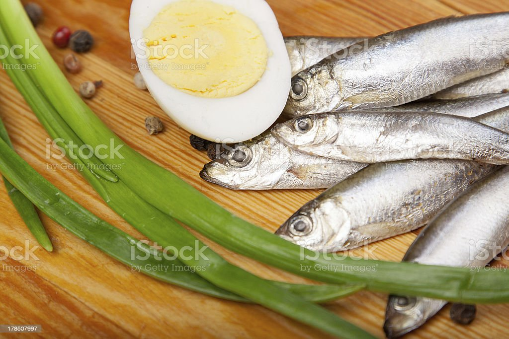 salted anchovies, egg, and spring onion on wooden royalty-free stock photo