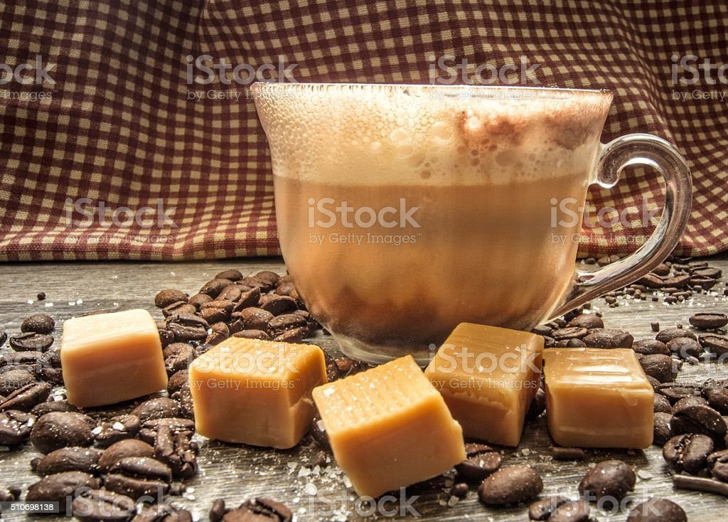 Salted Caramel Latte With Caramel, Coffee Beans And Sea Salt stock photo