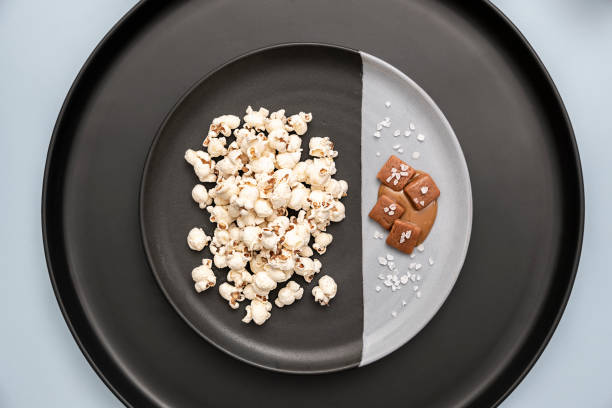 salted caramel popcorn - anthony mcgovern stock photos and pictures