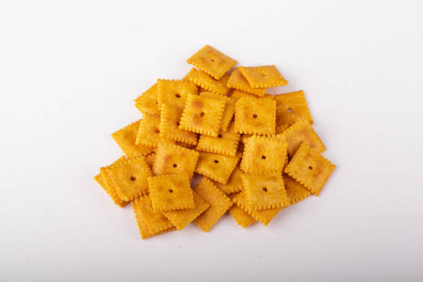 Salted Cheese Crackers on White Background stock photo