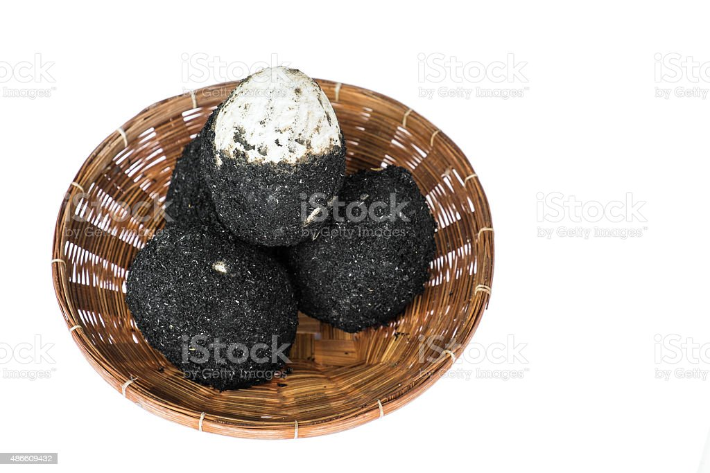 Salted eggs in rattan basket stock photo