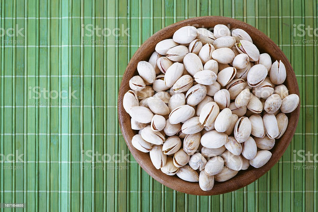 Salted peanuts in wooden bowl royalty-free stock photo