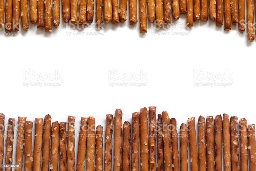 salted pretzel sticks on white background stock photo