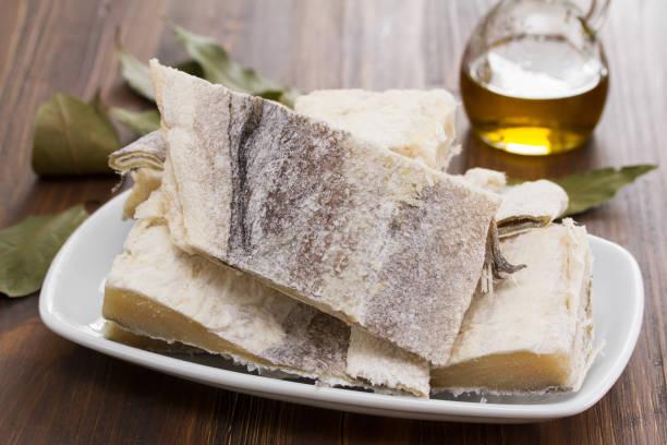 salted raw dry cod fish on dish - cod imagens e fotografias de stock