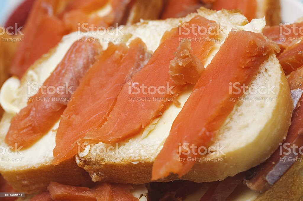 salted red pieces of fish on a bread. delicacy food royalty-free stock photo