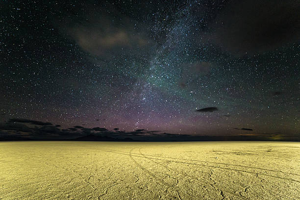 Salted Sky The night sky, including the Milky Way, over the salt pan at Bonneville Salt Flats in Utah lake bed stock pictures, royalty-free photos & images