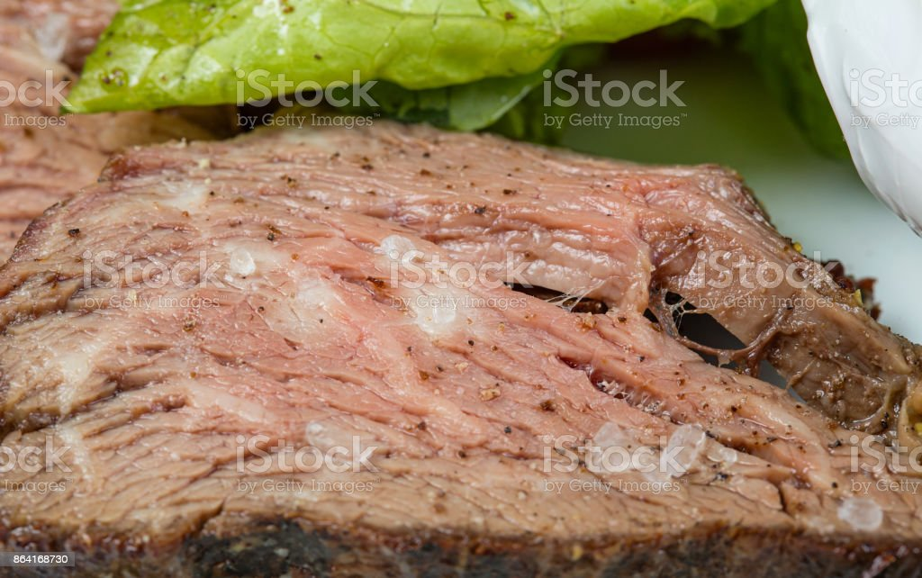 Salted veal slices and green vegetables royalty-free stock photo