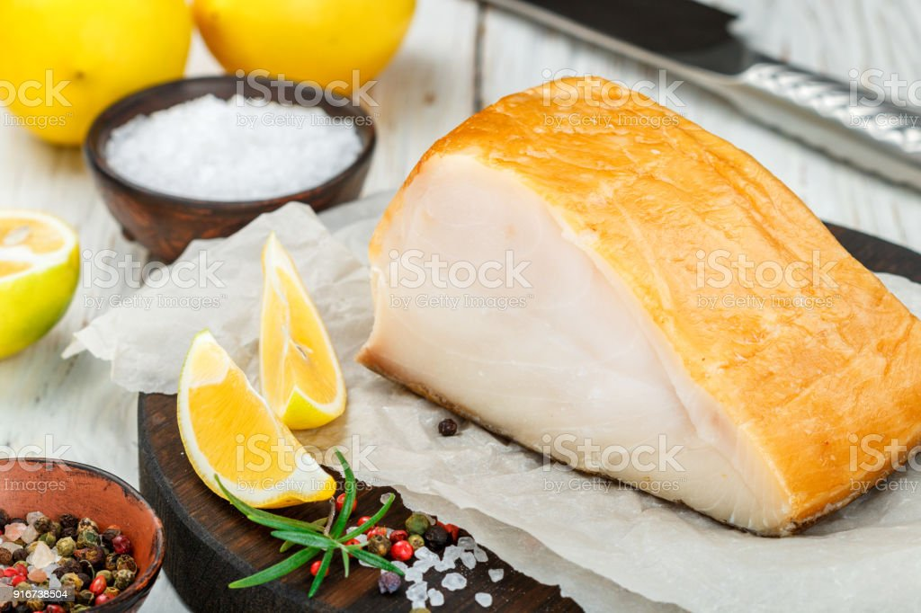 Salted white fish with lemon, rosemary and spices salt and pepper.  Butterfish. Halibut stock photo