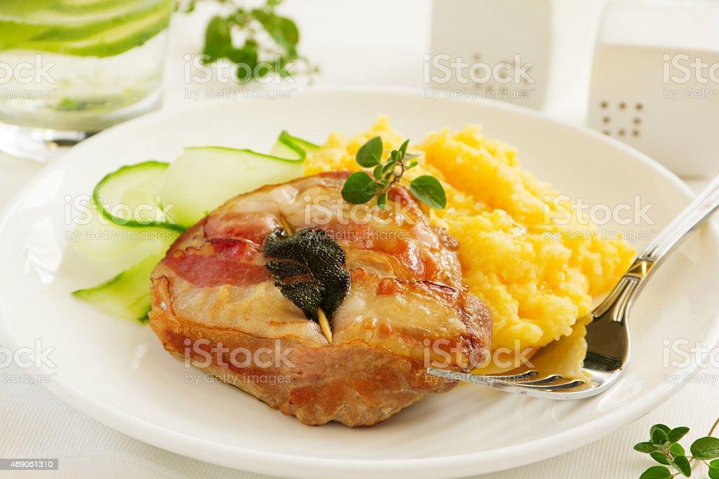 Saltimbocca with salad and polenta. stock photo