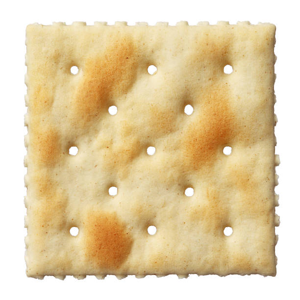 Saltine soda cracker isolated on white background stock photo