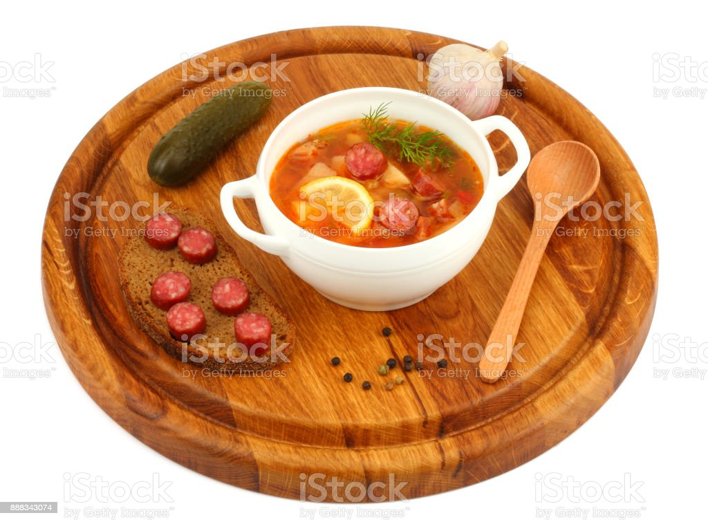 saltwort russian beef, pork and sausage soup solyanka with lemon, salami in plate isolated on white background stock photo