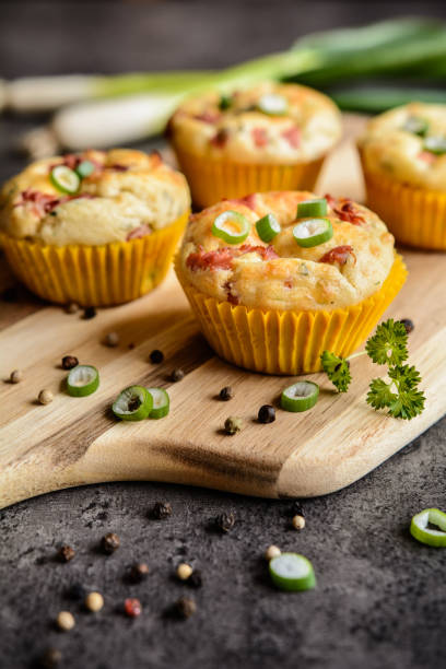 Salty bacon muffins with onion stock photo