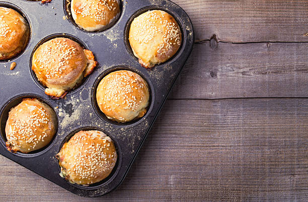 Salty muffins in a baking pan stock photo