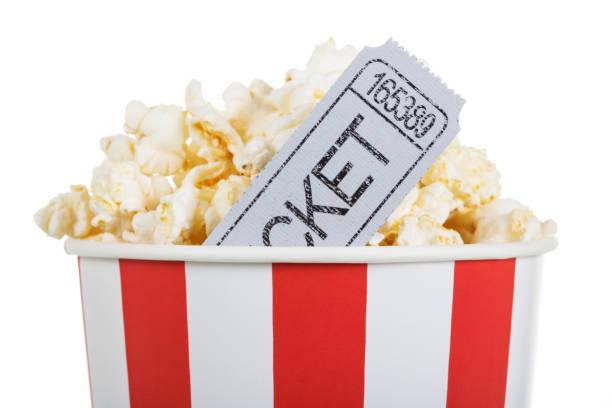 salty popcorn in box and movie ticket, isolated on white. - biglietto del cinema foto e immagini stock