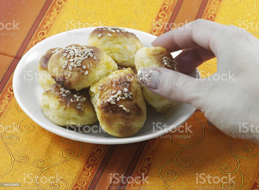Salty potato pastry with sesame stock photo