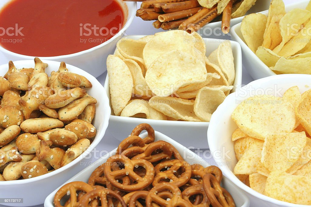 Salty snacks and salsa dip royalty-free stock photo