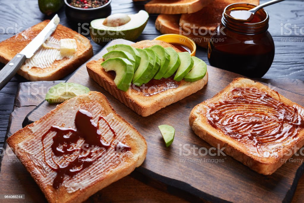 salty toasts with butter, avocado, yeast spread - Royalty-free Above Stock Photo