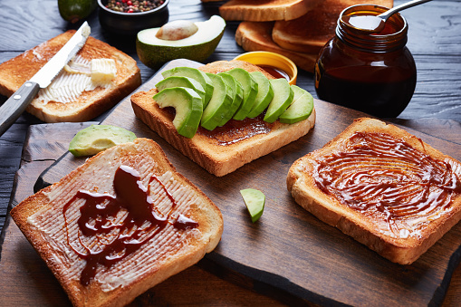 Salty Toasts With Butter Avocado Yeast Spread Stock Photo - Download Image Now