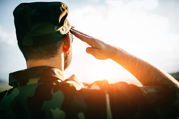 saluting - saluting stock photos and pictures