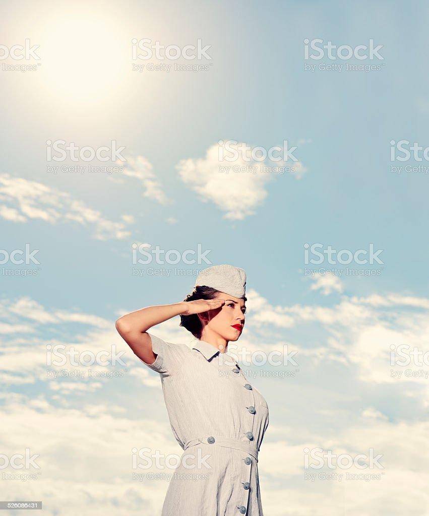 Saluting WWII Nurse - In Uniform stock photo