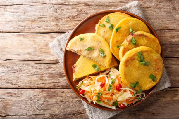 Salvadoran pupusa served with curtido closeup. horizontal top view stock photo