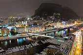 Night view of Salzburg and the Salzach River after a snowfall. Salzburg, Austria. Canon EOS 5D Mark II