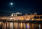 Salzburg, Austria - August 27, 2015: oldtown of salzburg / austria at night. In the foreground the state bridge (german: Staatsbruecke) over the salzach river, in the background the castle Hohensalzburg
