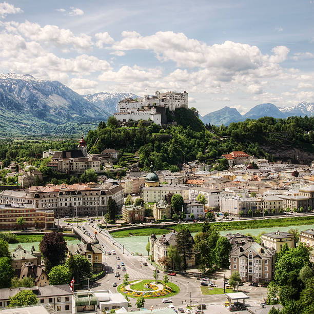 Salzburg Austria Salzburg's famous old town and emerald-colored Salzach River with northern Alpine ridge in the background.    davelongmedia stock pictures, royalty-free photos & images