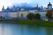 Salzburg cityscape at sunrise from Makartsteg bridge, austria – long exposure blurred Salzach river